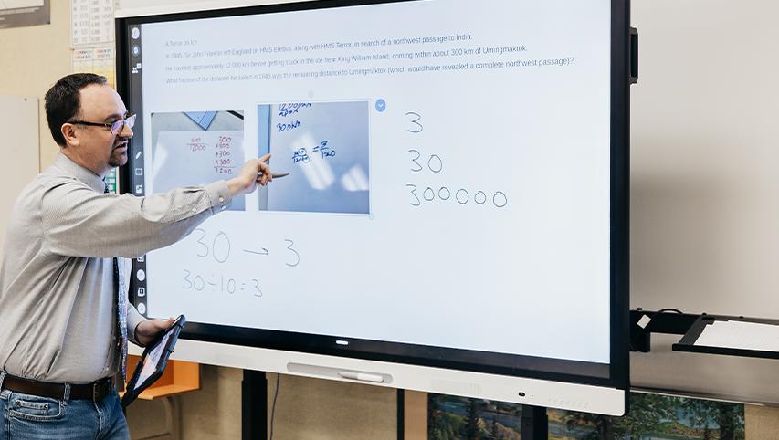 Teacher using an interactive whiteboard