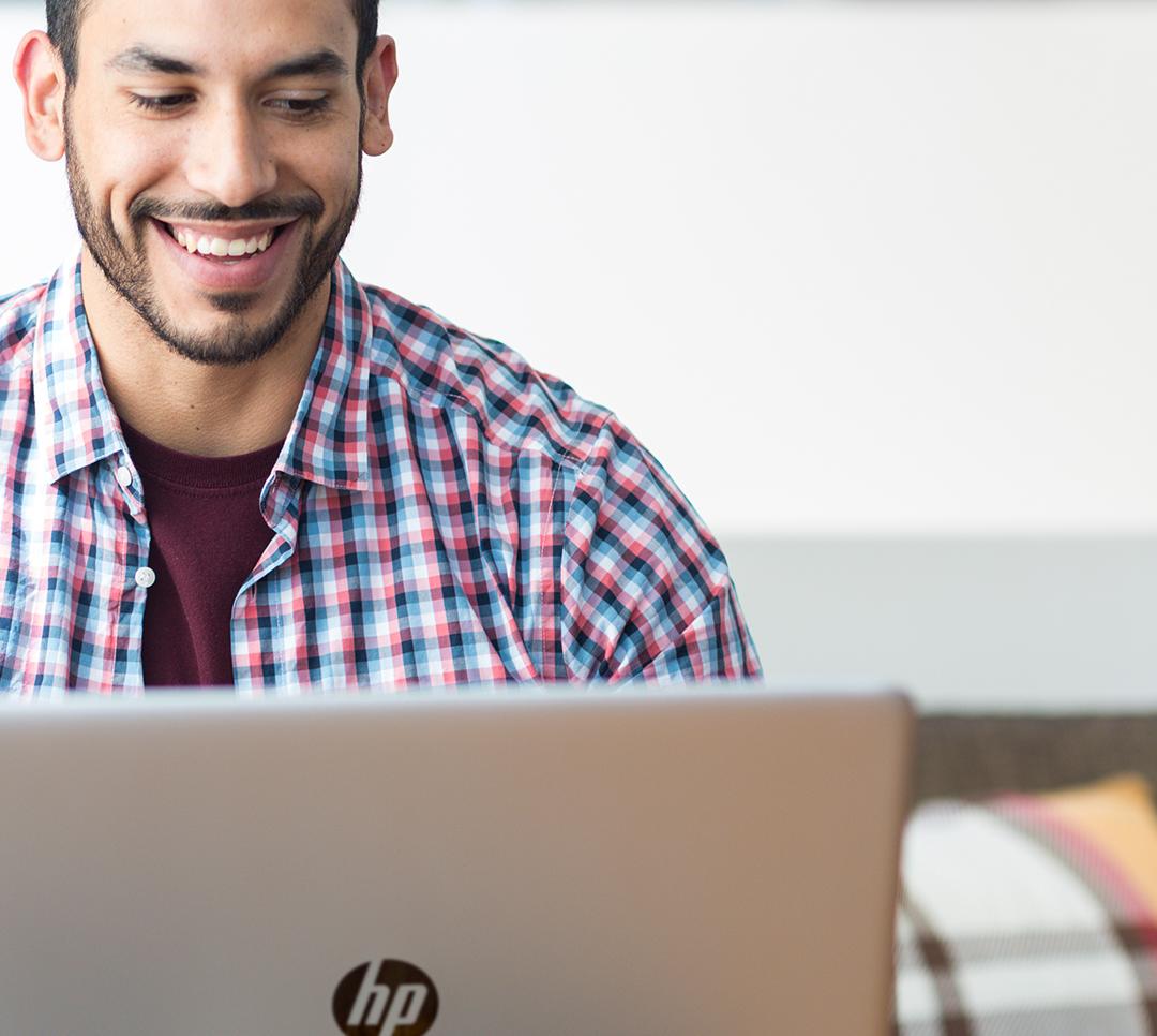 Man using HP laptop