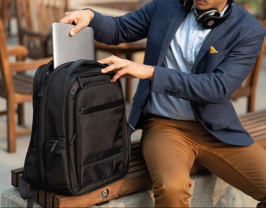Man putting a laptop in a bag