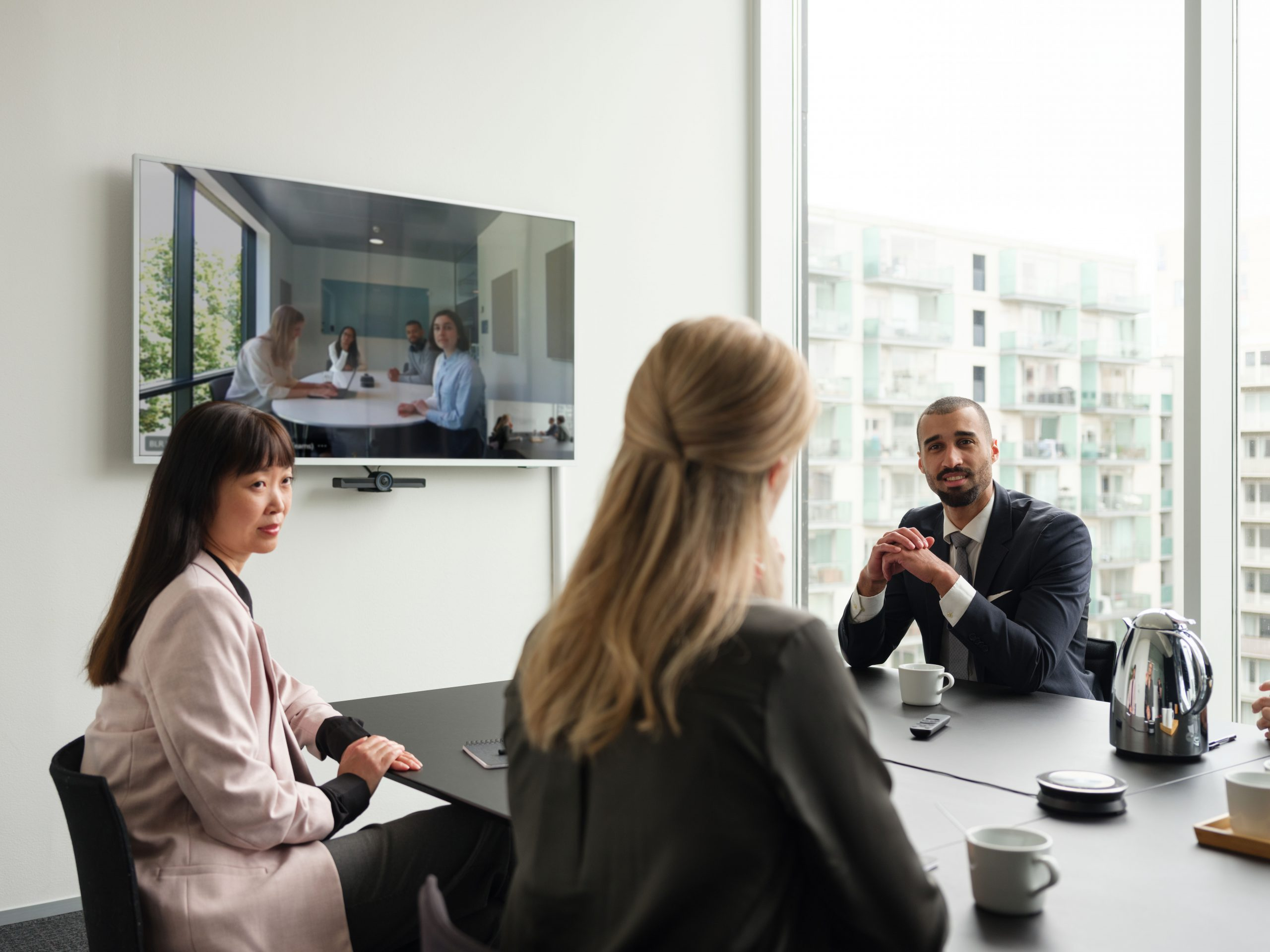 Two women and one man in a business meeting