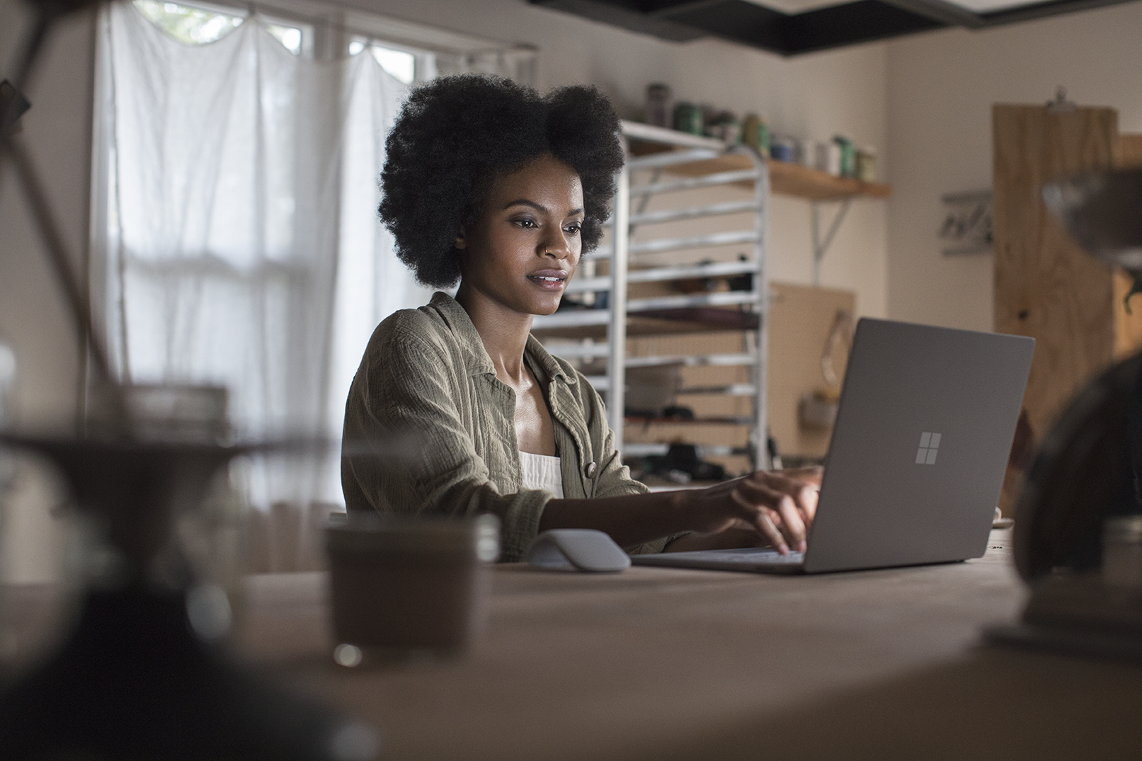 Woman working on a Microsoft Device