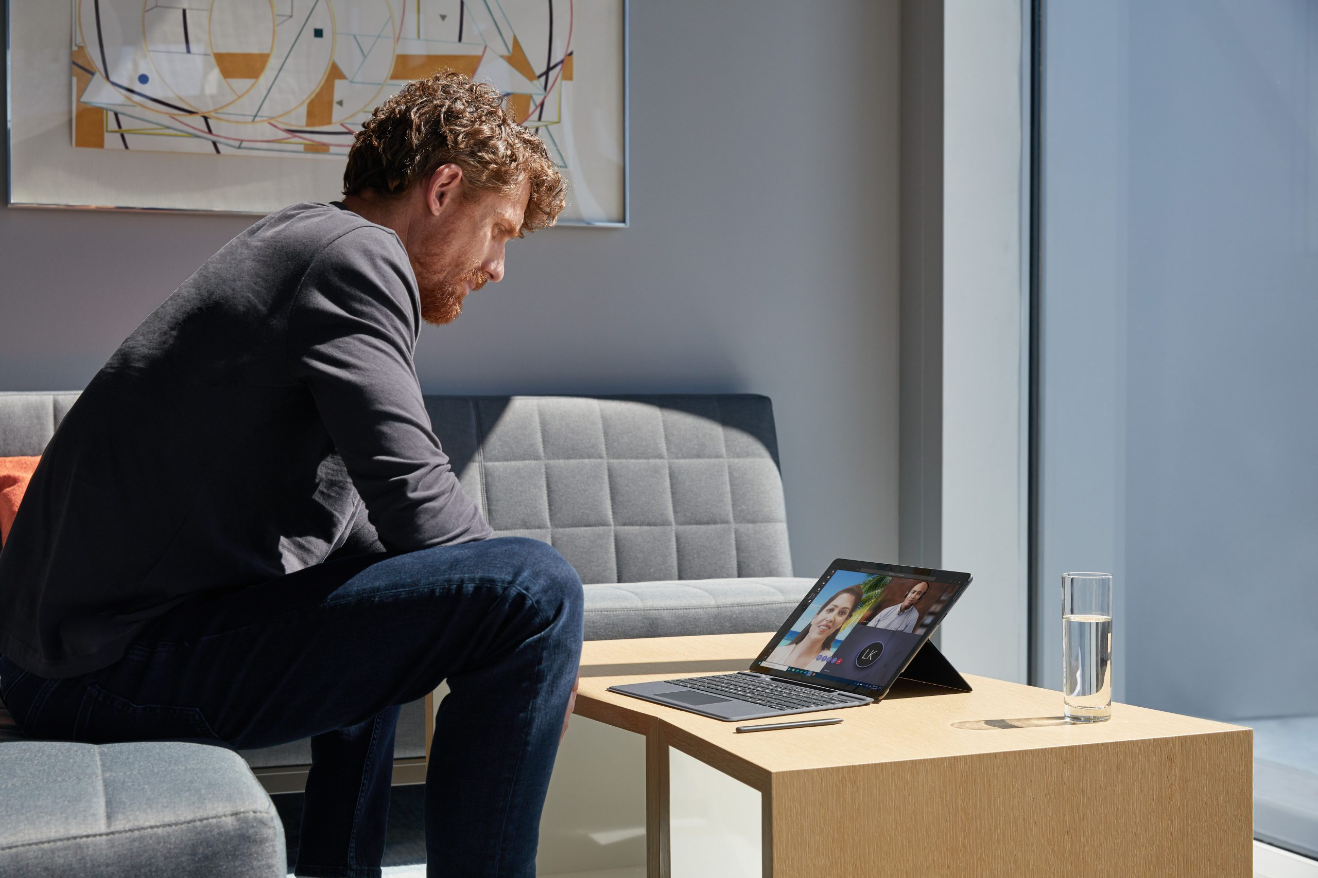 A man using a Surface device at home
