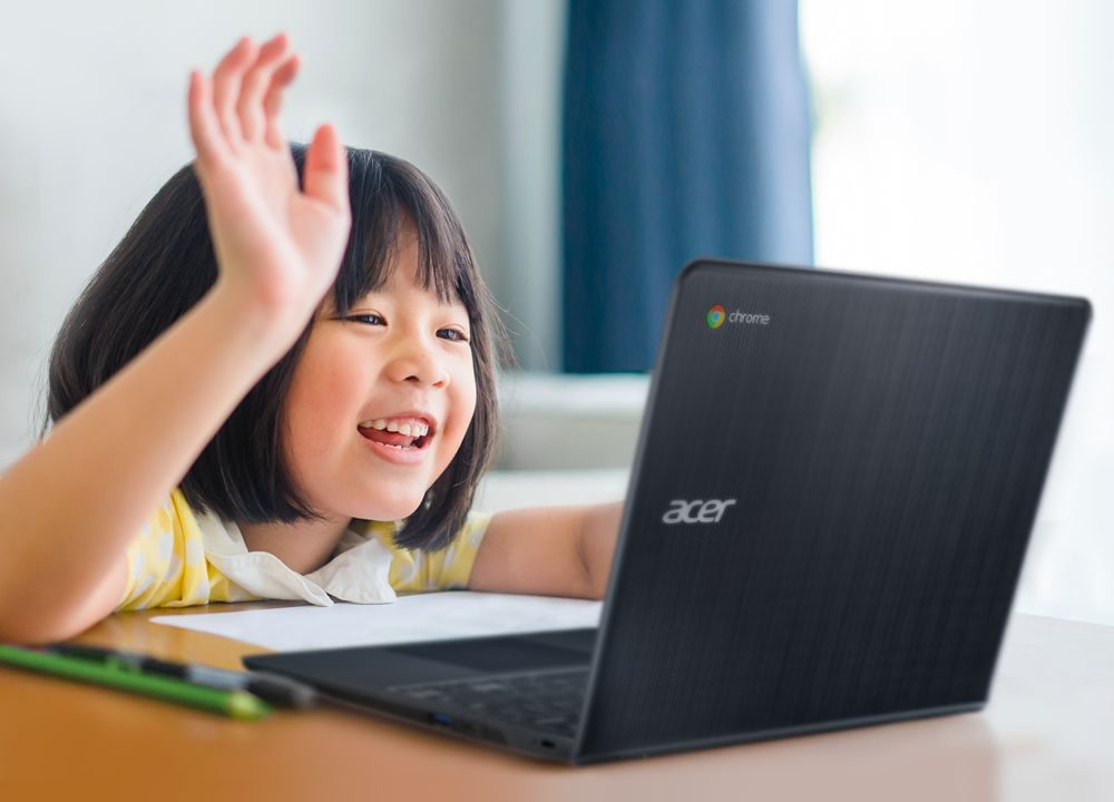 Young girl using Acer laptop
